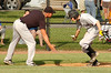 Burton third base caoch congratulates #8 Hunter Farmer, who just hit a home run. Photo by Ned JIlton II