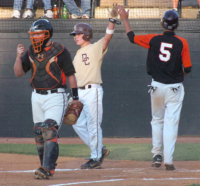 #5 for David Crockett and #5 for Sullivan Central high five after giving the Tennessee team a 2-0 lead. Photo by Ned Jilton II