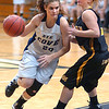 Rye Cove's #20, Lucindy Lawson, drives past Sullivan North's #3, Katlin Woods. Photo by Ned Jilton II