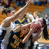 Sullivan North's #20, Michala Baker, battles with Rye Cove's #42, Hannah Goins and #40 Elizabeth Peak, to hang onto the ball.Photo by Ned Jilton II