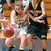 Rye Cove's #12, Courtney Smith, and Sullivan North's #14, Alyssa Gilliam, go after loose ball. Photo by Ned Jilton II