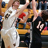 Elizabethton's #14, Alex Bauchman, gets a hand on the shot of Sullivan North's #44, Chase Arnold. Photo by Ned Jilton II