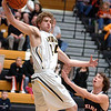 Sullivan North's #44, Chase Arnold, pulls down a high pass under the basket and over Elizabethton's #14, Alex Bauchman. Photo by Ned JIlton II