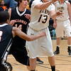 Sullivan North's #13, Cory Rowe, passes out of traffic in the lane. Photo by Ned Jilton II