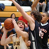 Sullivan North's #44, Chase Arnold, attempts to shoot against the double team of Elizabethton's #14, Alex Bauchman, and #42, Zach Norwood. Photo by Ned JIlton II