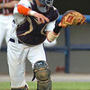 Catcher for the Virginia all-star team makes the throw to first after a third strike got away. Photo by Ned Jilton II