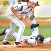 #7, wearing a Virginia High Uniform and a J.I. Burton helmet, sprawls safely back into first ahead of the tag by #21 from TN High. Photo by Ned Jilton II