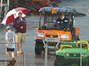 Coaches and grounds keepers wait out the two and a-half hour rain delay. Photo by ned Jilton II