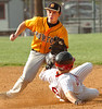 #2 for J.I. Burton moves to tag out a sliding #6 from Wise Central who was caught stealing. Photo by Ned Jilton II