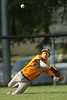 #3 for J.I. Burton makes a diving attempts on a fly ball to shallow left field. Photo by Ned Jilton II
