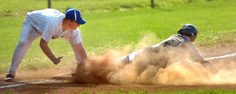 #13 is tagged out in a cloud of dust by the castlewood third baseman. Photo by Ned Jilton II