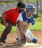 The ball eludes the mitt of the Castlewood catcher. Photo by Ned Jilton II
