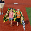 Record-Eagle/Keith King<br /> Taylor Ferguson, left, 6, of Kingsley, and her brother, Conner Ferguson, 6, wear taco costumes as they race each other toward third base Tuesday, July 19, 2011 at Wuerfel Park between innings of the game between the Traverse City Beach Bums and the Washington Wild Things.