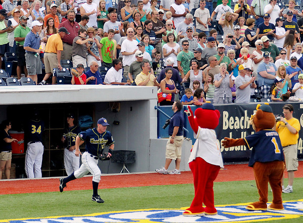 Record-Eagle/Keith King<br /> Fans cheer as the Traverse City Beach Bums' Tom Zebroski jogs onto the field during the announcements of the starting lineup Tuesday, July 19, 2011 prior to the game against the Washington Wild Things at Wuerfel Park.