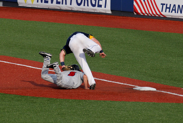 Record-Eagle/Keith King<br /> The Traverse City Beach Bums' Chase Burch tags the Washington Wild Things' Kevyn Feiner as Feiner attempts to return to first base Tuesday, July 19, 2011 at Wuerfel Park. Feiner was called safe on the play.