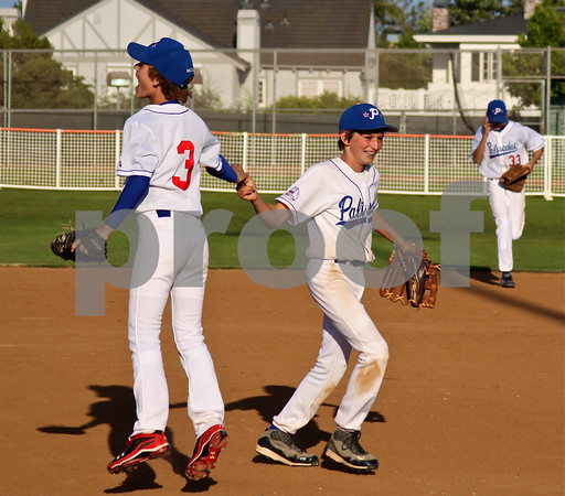 Emmett Collins (left) and Gabe Stewart start to celebrate after the final out