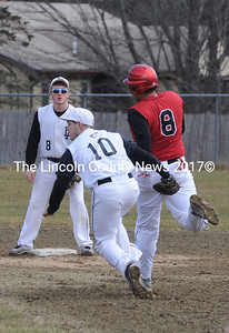 AJ Oliver runs down Dylan McMahon after he was caught off base.