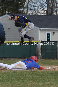 Brandon Soper soars in the air to catch a wild throw and attempts to tag out a Mt.Ararat baserunner in scrimmage action at Medomak Valley.