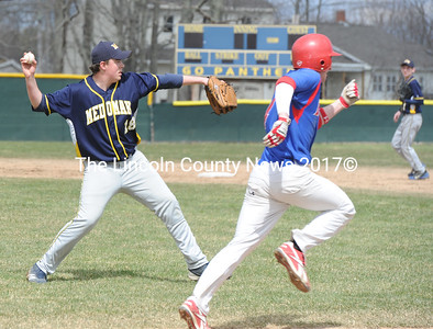 Tyler Emerson fields a bunt and throws a Mt.Ararat baserunner out at first in pre-season scrimmage action at Medomak Valley on Monday.