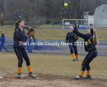 Heidi Obuchon makes the catch for the Lady Panthers as teammate Hannah Marks looks on.
