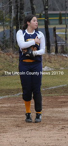 Amanda Hendrickson tries to keep her hands warm in freezing temperatures on Saturday.