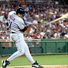 Mike Piazza of the NY Mets as his bat shatters and flies away; only the small handle is left in his hands.