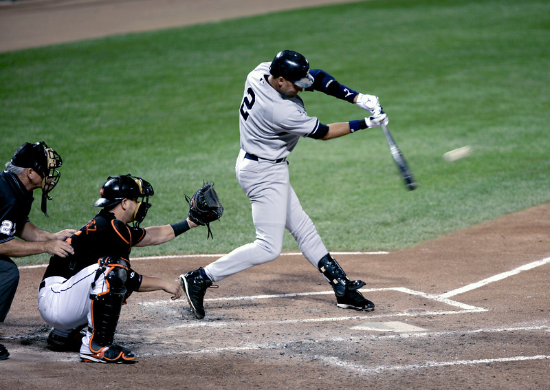 Derek Jeter's swing just after making contact in a game against the Baltimore Orioles at Camden Yards.