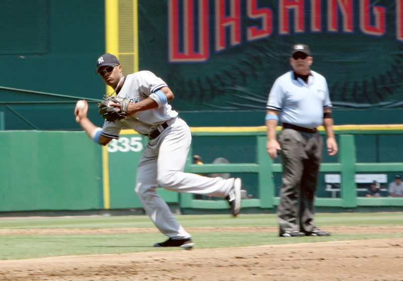 Robinson Cano fields a grounder and prepares to throw to first base in a game against the Washington Nationals at the old RFK Stadium.