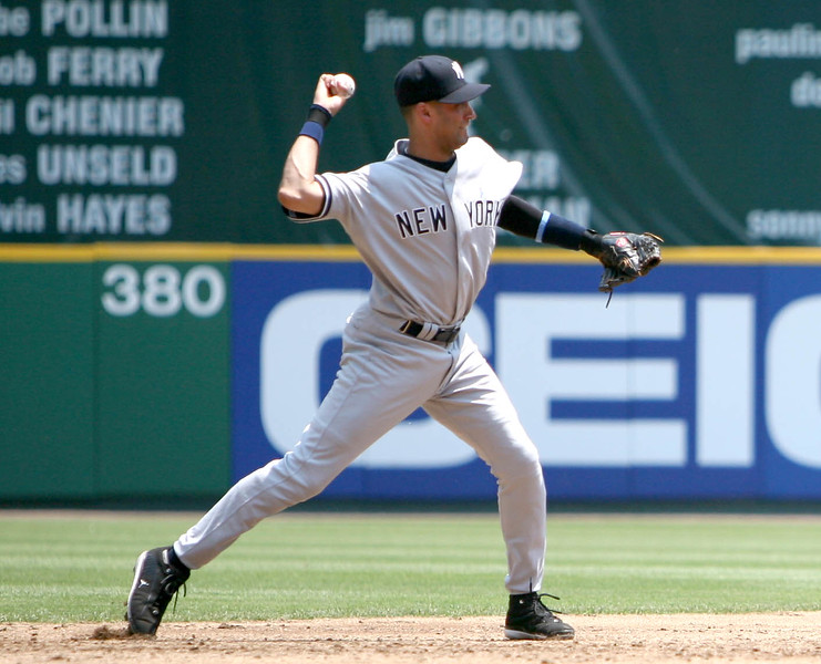 Derek Jeter preparing to throw a runner out from short in a game against the Washington Nationals at the old RFK Stadium.