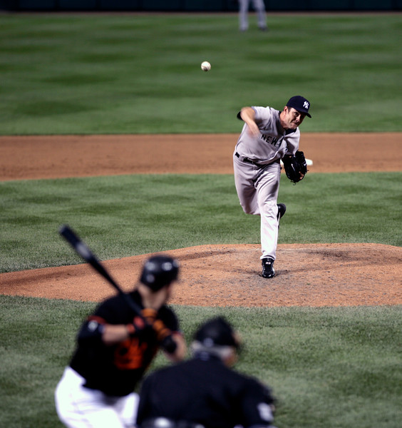 Mike Mussina delivers a pitch against the Baltimore Orioles at Camden Yards.