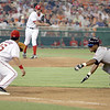 This pickoff play shows pitcher Gary Majewski throwing to Washington Nationals teammate Wil Cordero at first base as the N.Y. Mets' Jose Reyes starts his dive back into the bag.