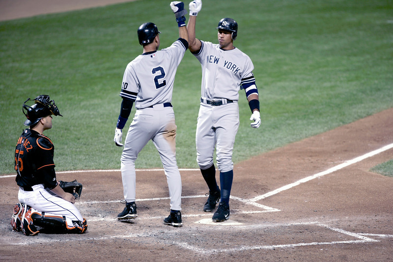 Derek Jeter congratulates Alex Rodriguez on driving him in with a two-run homer against the Baltimore Orioles.