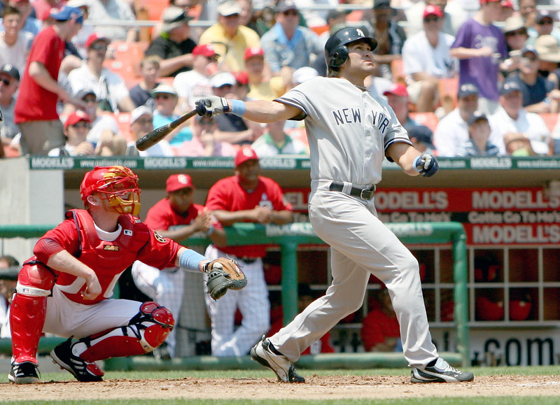 Johnny Damon follows through his swing and tracks the resulting fly ball in a game against the Washington Nationls at the old RFK Stadium.
