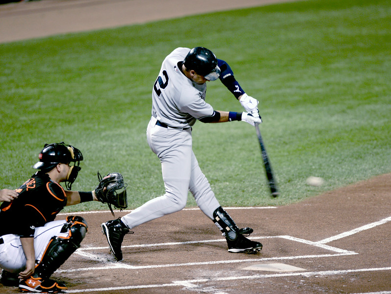 Derek Jeter about to make contact during a game against the Baltimore Orioles.
