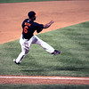 Melvin Mora of the Baltimore Orioles leaves his feet to make a throw to first base in a game against the Yankees at Camden Yards.