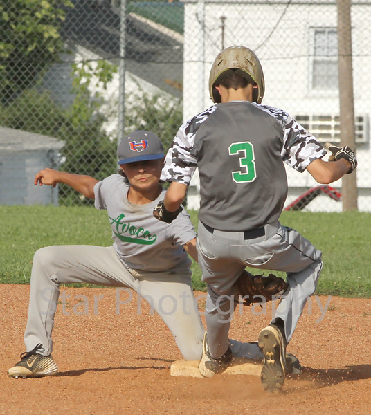Avoca shorthstop Isaac Hood (10) tags out the Green Tornado's Alex Hawk (3) as he tries to steal second base in the top of the second inning.