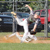 Avoca's Dalton Eads (27) slides into third safely as the throw sails wide of third baseman Noah Warren.<br /> Star Photo/ Larry N. Souders.
