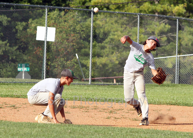 Avoca shortstop Isaac Hood (10) fires to first for an out in the top of the third inning Thursday evening.