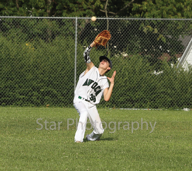 Avoca's centerfielder (38) draws a bead on a fly ball to end the top of the third inning.<br /> Star Photo/Larry N. Souders