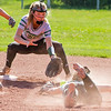 Record-Eagle/Brett A. Sommers Traverse City West's Tacey Looze (left) and Ally Phlad scramble for a ground ball, but Kalkaska's Makenzie Wilkinson reached second base safely during Thursday's game. West won the doubleheader opener 3-1.