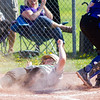 Record-Eagle/Brett A. Sommers Traverse City West's Ana Walters slides safely across home plate to score the Titans' third run of the third inning of Thursday's game against Kalkaska. West won the opener 3-1.