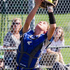 Record-Eagle/Brett A. Sommers Kalkaska catcher Ayla Gustafson catches a foul ball during Thursday's game against Traverse City West. West won the opener 3-1.