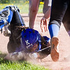 Record-Eagle/Brett A. Sommers Kalkaska catcher Ayla Gustafson makes a diving attempt to catch a foul ball during Thursday's game against Traverse City West. West won the opener 3-1.