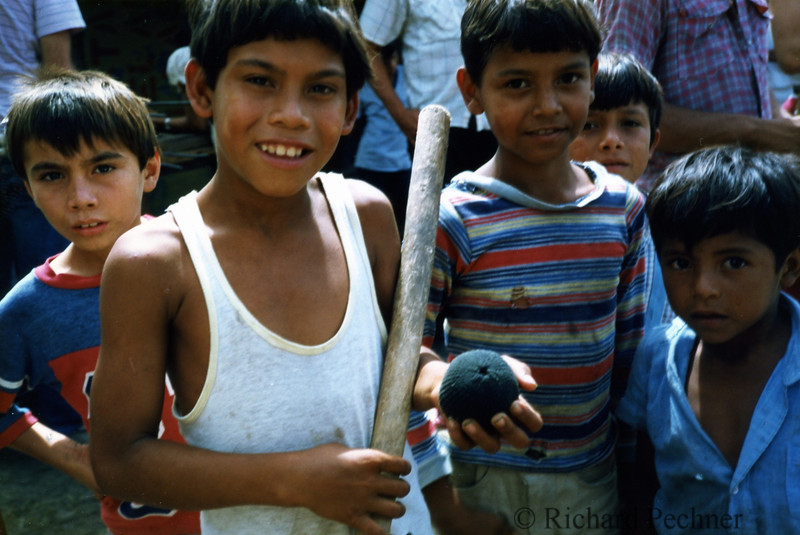 """example of """"bat and ball"""" local kids learn to play the game with: ball is a sock stuffed with rocks and a hand smoothed stick for a bat"""