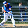 Leominster's Marc Poirier drives a base hit to left field. SENTINEL & ENTERPRISE / GARY FOURNIER