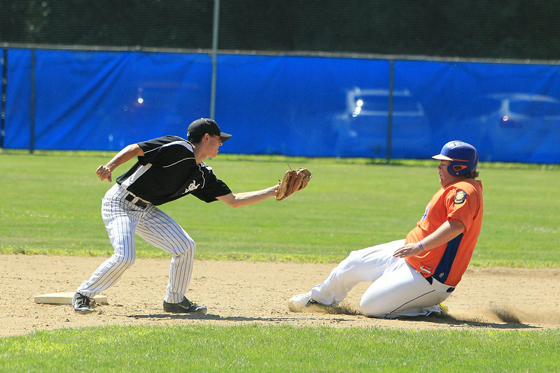 Leominster's Brennan Cuddahy is tagged out sliding into second during Saturday's American Legion playoff game against Main South in Leominster. 	SENTINEL & ENTERPRISE / SCOTT LAPRADE