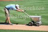 It is sometimes cool to watch the stadium workers care for the field prior to a game.