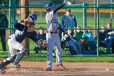 Tree of Life School's Catcher #10 Grant O'Connell goes after a loose ball as Bishop Hartley High School's #12 Caleb Parker signals for his team to hold their positions on base Friday afternoon April 9, 2010 at the Ridgeview Middle School. (© James D. DeCamp | http://www.JamesDeCamp.com | 614-367-6366)