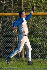 Tree of Life School's #12 Charles Collins reaches for an outfield catch in as his baseball team takes on Bishop Hartley High School Friday afternoon April 9, 2010 at the Ridgeview Middle School. (© James D. DeCamp | http://www.JamesDeCamp.com | 614-367-6366)