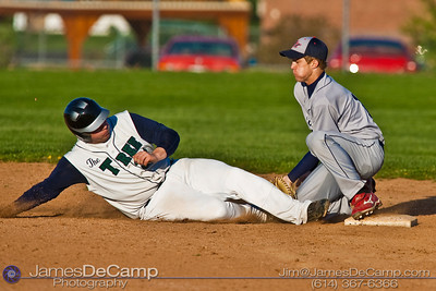 Tree of Life School's #31 Elliot Hagans is taged out by Bishop Hartley High School's #12 Caleb Parker as he tries to slide back into second base Friday afternoon April 9, 2010 at the Ridgeview Middle School. (© James D. DeCamp | http://www.JamesDeCamp.com | 614-367-6366)